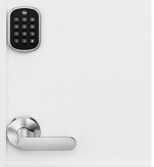 Door with smart lock showing the keypad control