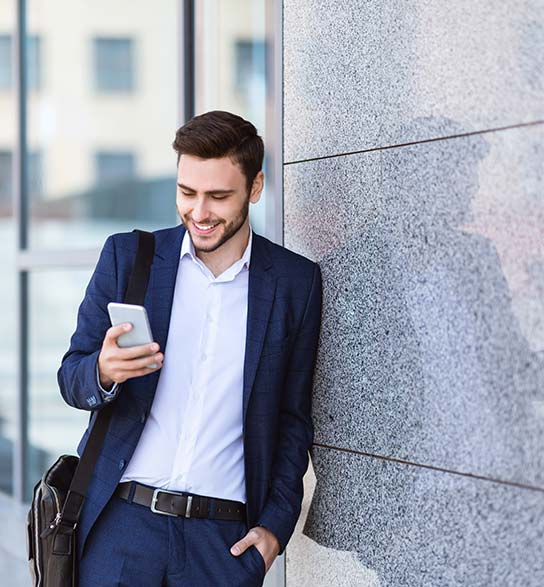 Man looking at mobile phone with app for home security