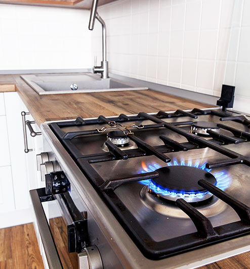 Gas stove in kitchen left on which is a hazard for combustible gas explosion